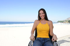 Woman in wheelchair enjoying outdoors beach Stock Image