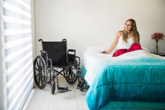 Woman in wheelchair feeling optimistic Stock Photography