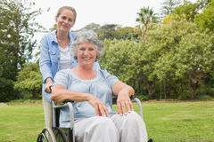 Woman in wheelchair with her daughter Royalty Free Stock Images