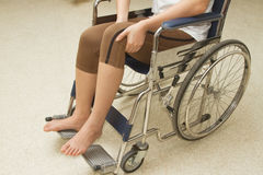 Woman in a wheelchair stock images