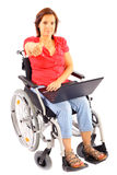 Woman in wheelchair with laptop Royalty Free Stock Image