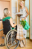 Woman in wheelchair meeting assistant Stock Photo