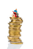 Woman in wheelchair on money stack Royalty Free Stock Photos