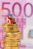 Woman in wheelchair on money stack. Symbol photo for disability care allowance and costs public health Stock Image