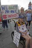 Woman in a Wheelchair and Others Protest Donald Trump's Hatred a Royalty Free Stock Photo