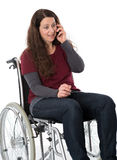 Woman in wheelchair with phone Stock Photo