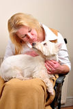 Woman in a wheelchair is talking to her dog Stock Photo