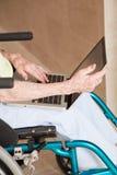 Woman on Wheelchair Using Laptop Stock Photo