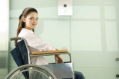 A woman in a wheelchair waiting for the lift Stock Images
