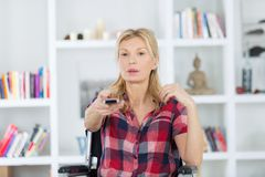 Woman in wheelchair watching tv Royalty Free Stock Photos