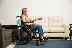 Woman in wheelchair watching TV Stock Image