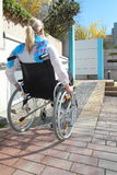Woman in a wheelchair on a wheelchair ramp royalty free stock photo