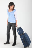 Woman wheeling luggage Stock Photos