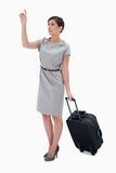 Woman with wheely bag calling a taxi Royalty Free Stock Photos