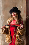 Woman with a whip Royalty Free Stock Photo