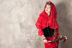 Woman with a whip. Beautiful young woman with a whip near the wall Stock Image
