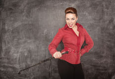 Woman with whip in her hand Stock Photos