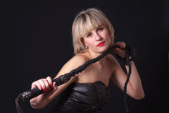Woman with a whip in her hand Stock Photos
