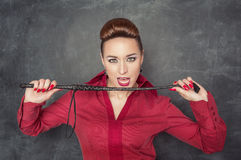 Woman with whip in her hands Stock Photos