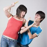 Woman whip  a man with a swift. A young woman ready to whip with a swift a young man Stock Image