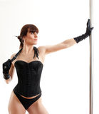 Woman, whip and pole Royalty Free Stock Image