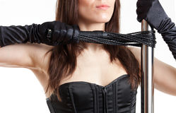 Woman, whip and pole Royalty Free Stock Photography