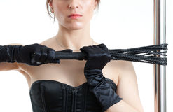 Woman, whip and pole Stock Images