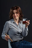 Woman with whiskey Stock Photography