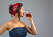 Woman with whiskey Royalty Free Stock Photos