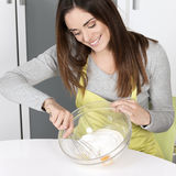 Woman whisking batter Stock Photo