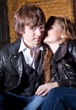 Woman whispering on boyfriends ear on street Stock Photo