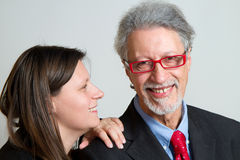 Woman whispering an exciting news. To her father Royalty Free Stock Photos