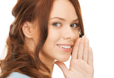 Woman whispering gossip Royalty Free Stock Image