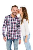 Woman whispering into mans ears Royalty Free Stock Photos