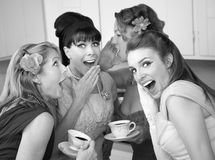 Woman Whispering Secret. Group of four retro fashion housewives tell secrets in the kitchen royalty free stock image