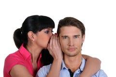 Woman whispering a secret. A women whispering a secret to a man Royalty Free Stock Photos