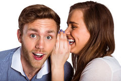 woman whispering secret into friends ear Royalty Free Stock Images