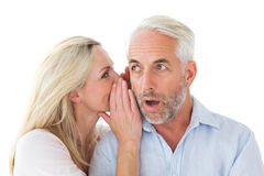 Woman whispering a secret to husband Royalty Free Stock Photos