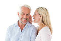 Woman whispering a secret to husband Royalty Free Stock Photo