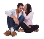Woman Whispering To Boyfriend's Ear Royalty Free Stock Photos