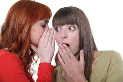 Woman whispering Stock Photography