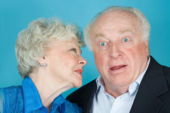 Woman whispering to husband Royalty Free Stock Photography