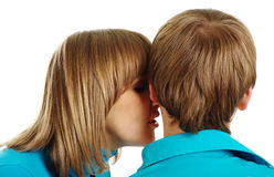 Woman whispers in the ear of man Stock Photo