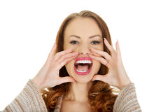 Woman whispers a gossip. Stock Images