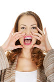 Woman whispers a gossip. Royalty Free Stock Images