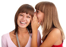 Woman whispers to the girlfriend secrets Stock Photos