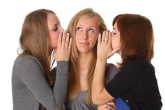 Woman whispers to girlfriend secrets Royalty Free Stock Image
