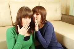 Woman whispers to the girlfriend secrets Royalty Free Stock Images