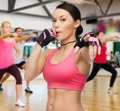 Woman with whistle in gym. Fitness, sport, training, gym and lifestyle concept - beautiful sporty women with whistle in gym Royalty Free Stock Photos