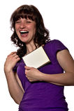 Woman whit big smile and blank CD cover. Woman in purple shirt big smile and blank CD cover on white background royalty free stock photo